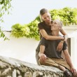 Tourist Couple on Stone Wall — Stock Photo #33824813