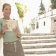 Stock Photo: Woman with Guidebook