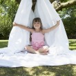 Stock Photo: Girl in backyard in tent