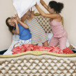 Teenage Girls pillow fighting — Stock Photo