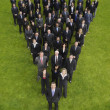 Business people standing in triangle formation — Stock Photo