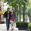 Couple walking on sidewalk — Stok Fotoğraf #33825543