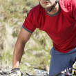 Cyclist in field — Stock Photo