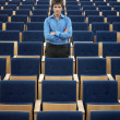 Businessmstanding in Auditorium — Stock Photo #33826423