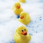 Rubber ducks in bubble bath — Stock Photo #33826709