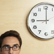 Businessman looking to clock — Stock Photo #33826711