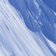 Skier on mountain slope — Stock Photo #33826719