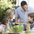 Stock Photo: Family having lunch