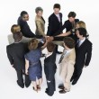 Stock Photo: Businesspeople in circle joining hands