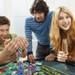 Man with friends at roulette table — Stock Photo #33826903