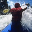 Stock Photo: Kayaker paddling through Rapids