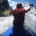 Kayaker paddling through Rapids — Stock Photo #33828877
