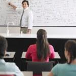 Students listening to teacher — Stock Photo