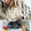 Stock Photo: Couple Reading Map
