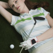 Golfer Lying on Green with Putter — Stock Photo