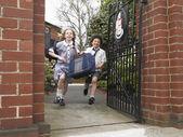 Friends Running From School — Stock Photo