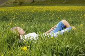 Woman sleeping in meadow — Stok fotoğraf