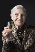 Senior woman with glass of wine — Stock Photo