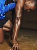 Runner crouching down — Stok fotoğraf