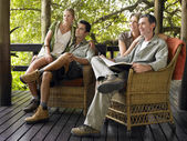 Two couples sitting on terrace — Stock Photo