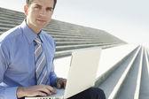 Businessman sitting on steps — Foto Stock