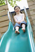 Girl on top of slippery slide — Stock Photo