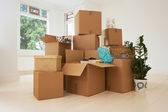 Stack of Boxes in New House — Stock Photo