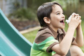 Little boy using inhaler — Stock Photo
