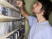 Man Selecting a CD — Stock Photo