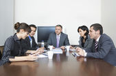 Business people having a discussion in conference room — Stock Photo