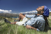 Man lying in field feeling sun — Stock Photo