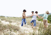 Children playing ring around the rosy — Stock Photo