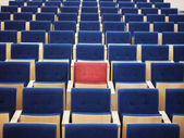 Red Seat in group of blue — Stock Photo