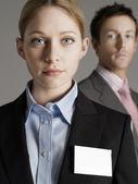 Businesswoman with businessman — Stock Photo