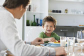 Boy Eating Meal with Father — Stock Photo