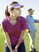 Young woman playing golf — Stock Photo