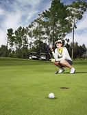 Disappointed female golfer — Stockfoto