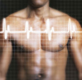 Man with electrocardiogram graph — Stock Photo