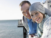 Couple standing on pier — Stock Photo