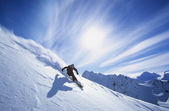 Person skiing on mountain slope — Stock Photo