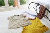 Female outfit laid out on bed — Stock Photo