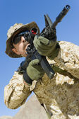 Soldier aiming through gunsight — Stock Photo