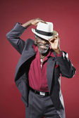 African Man Adjusting fedora — Stock Photo
