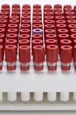 Test tubes with red lids — 图库照片
