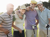 Golfers posing on court — Stock Photo
