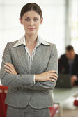 Businesswoman standing arms crossed — Stock Photo