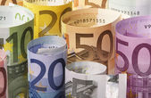 Rolled up Euro banknotes — Stock Photo