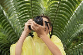 Boy taking picture — Stock Photo