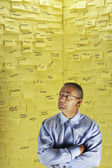 Man in front of wall covered in sticky notes — Stock Photo