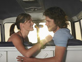 Couple face to face in front seat of van — Stock Photo